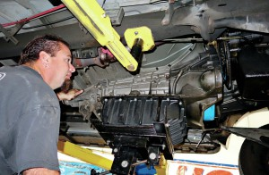 Removing a transmission for repairs.